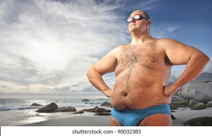 On beach Fat guy out checking the girls laying