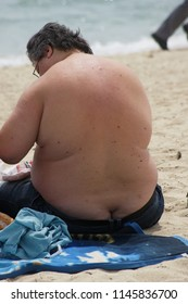 fat man sitting at the beach taking some sun Saint Tropez,French Riviera/France May 10 - 2014
