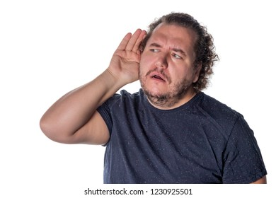Fat man, trying to hear someone putting his hand on his ear, standing on a white background