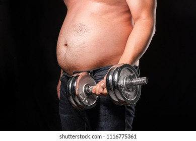 Fat man is trying to lift dumbbell to fit and firm