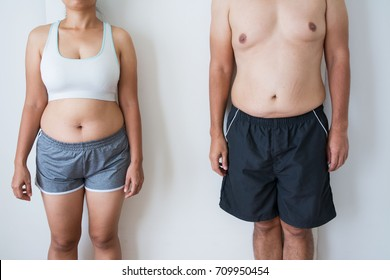 Fat man with fat woman on white background