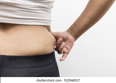 Fat overweight woman pinching her fat tummy isolated on white background,obese woman,Women with fat belly and stretch marks,Fat of a middle-aged lady