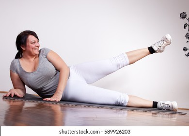 Fat plus size overweight woman working out excercising at home