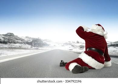 fat santa claus on road