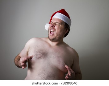 Fat santa having a go at pinching his sexy nipples