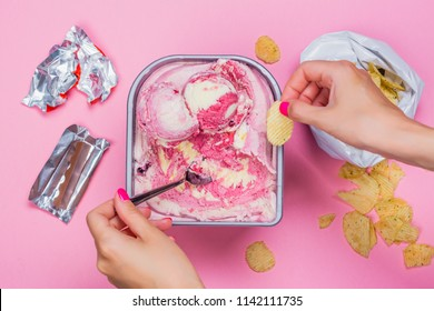 Fat sweet, unhealthy meal VS healthy lifestyle and sport. Snacks and fast food on pink background. Copy space