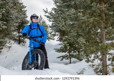 Fat tire bike. A young man riding fat bicycle in the winter