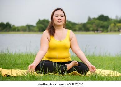 Fat woman do meditating