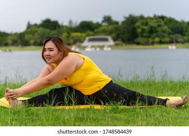 fat woman do yoga , asian Thailand