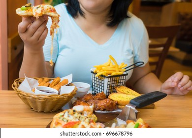 Fat woman enjoy eating pizza and fast food,unhealthy lifestyles,overweight female have big meal