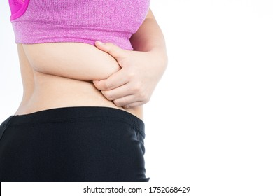 Fat woman holding excessive fat belly lower back, overweight fatty belly isolated on over white background. Diet lifestyle, weight loss, stomach muscle, healthy concept.