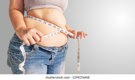 Fat woman  holding a measurement tape.body fat percentage with measuring tape for fat.