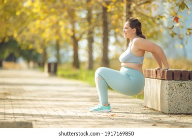Fat woman jogging, doing sports for weight loss, obesity problem. High quality photo.