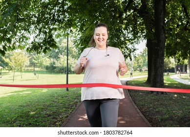 Fat woman reaching the finish line of race