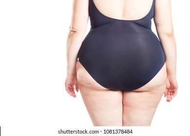 fat woman in a swimsuit turned with her back (isolated on white background)