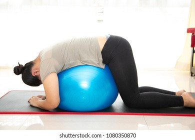 Fat women exercise with fitness ball.