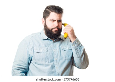 Fat young man holding a banana isolated on white background
