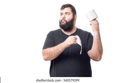 Fat young man holding a roll of toilet paper and with contented face isolated on white background