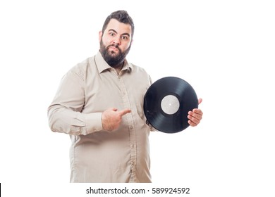 Fat young man holding a vinyl isolated on white background