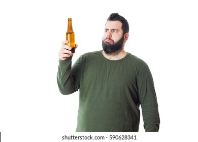 Fat young man holds beer bottle isolated on white background