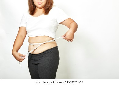 Fat young woman asian with measure tape studio on white background.