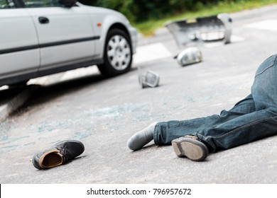 Fatal car accident involving a pedestrian. Drunk driver victim lying on the street