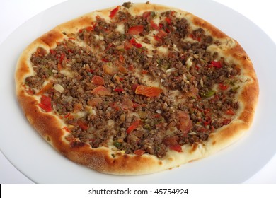 A fataya Arab bread, topped with meat and vegetable sauce before baking. Fataya, which comes in several varieties, the the Arab world's equivalent of a cheap pizza take-away.