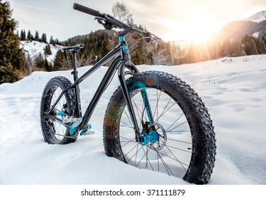 Fat-bike on the snowy mountain trail