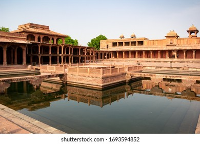 Fatehpur Sikri with a lot of columns located in Uttar Pradesh, India reflected in a water pool