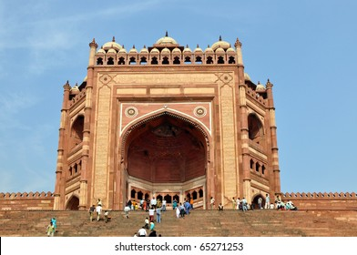 FATEHPUR SIKRI, INDIA - 3 NOVEMBER, 2009: An unidentified group of tourists enter the Buland Darwaza in on November 3, 2009. Buland Darwaza is the largest of gateways in the world.