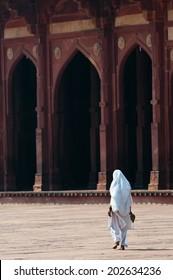 Fatehpur Sikri, India - February 26, 2013: Woman walking in the Jama Masjid mosque of Fatehpur Sikri town