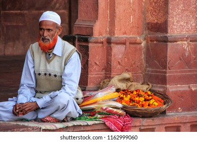 FATEHPUR SIKRI, INDIA-JANUARY 30: Unidentified man sells flowers in the courtyard of Jama Masjid on January 30, 2011 in Fatehpur Sikri, India. The mosque was built in 1648 by Emperor Shah Jahan
