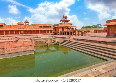 Fatehpur Sikri - Medieval fort city with view of Anup Talao a concert stage surrounded by water with view of ancient architecture at Agra India