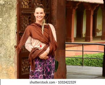 FATEHPUR SIKRI, UTTAR PRADESH / INDIA - 11 FEB 2018 : Unknown beautiful foreigner smiling with joy.