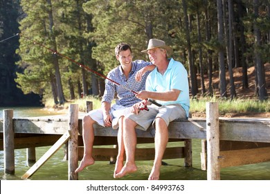 Father and adult son fishing together