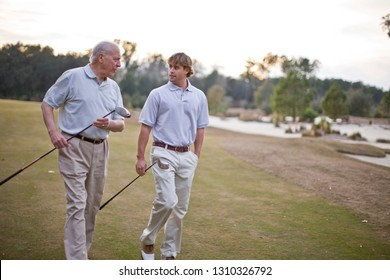 Father and adult son playing golf