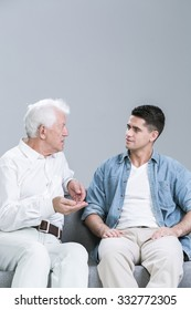 Father with adult son sitting and talking