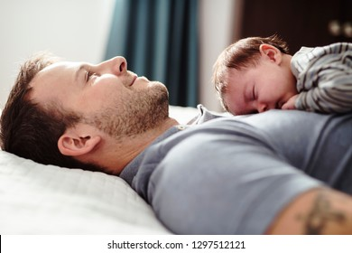 Father and Baby having wonderful time on bed on the morning