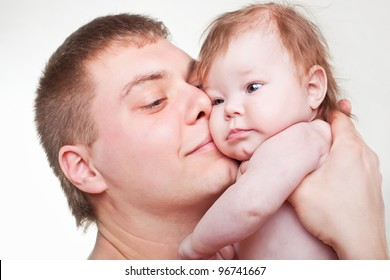 Father with baby on light background
