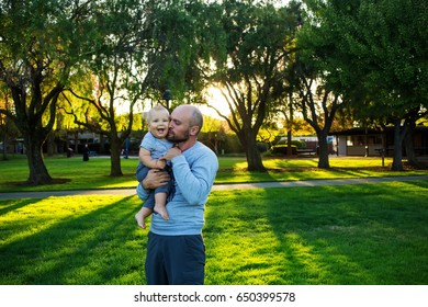 A father with baby son in green neighborhood