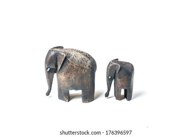 Father and baby wooden elephant on white background