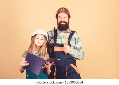 Father bearded man and daughter hard hat helmet uniform renovating home. Home improvement activity. Kid girl planning renovation. Child renovation room. Family remodeling house. Little fathers helper.