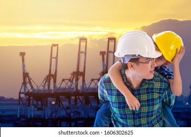 Father builder is carrying his son  in modern city Transportation port Sunset for industry and family boding future concept