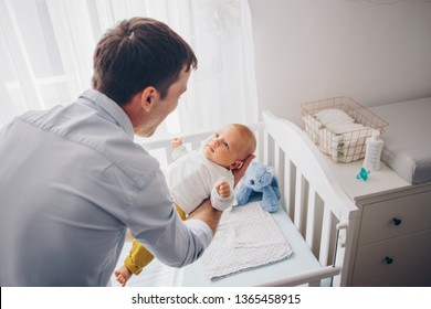 Father carrying baby son and and talk to it
