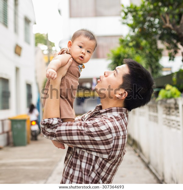 Father Carrying Baby Try Speak Him Stock Photo (Edit Now) 307364693