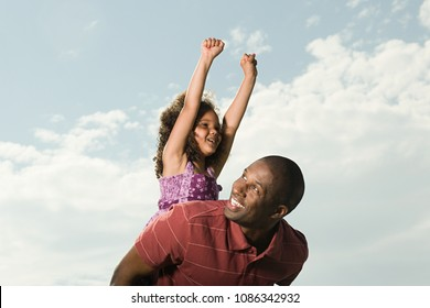 Father carrying daughter