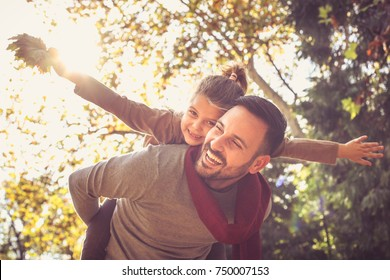 Father carrying his girl on piggyback, Love emotion.