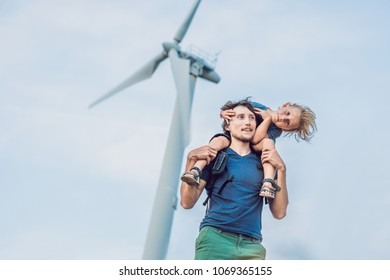 Father carrying son on shoulders and waving their arms like a windmill