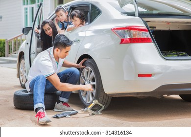 Father change tire and his family waiting between trip and accident was occured.