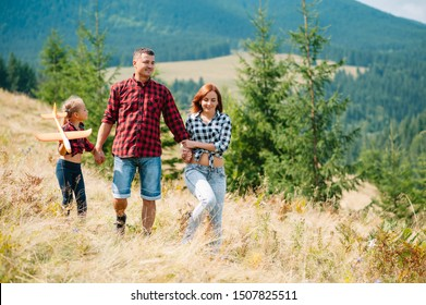 Father and child hiking in scenic mountains. Dad and son enjoying the view from the mountain top in Carpathian mountains